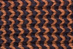 Knitting. Background knitted texture. Bright knitting needles. Black and brown woolen yarn for knitting stock photo
