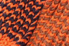 Knitting. Background knitted texture. Bright knitting needles. Orange and black wool yarn for knitting stock photography