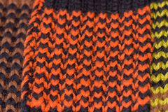 Knitting. Background knitted texture. Bright knitting needles. Orange and black wool yarn for knitting stock photo