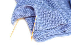 Knitting with bamboo needles Royalty Free Stock Photo