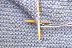 Knitting with bamboo needles Royalty Free Stock Images