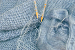 Knitting with bamboo needles Royalty Free Stock Photos
