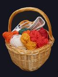 Knitting basket. With balls of yarn and needlework Royalty Free Stock Photo