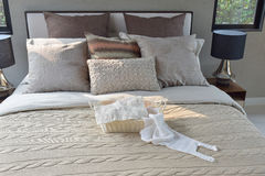 Knitting basket on warm classic style bedding with many texture of pillows Stock Images