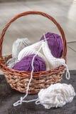 Knitting basket with yarns Stock Photo