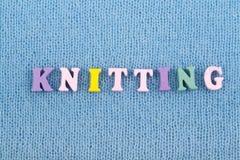 knitting Blauwe gebreide stoffentextuur Word van ABC-alfabetbrieven die wordt samengesteld royalty-vrije stock afbeeldingen
