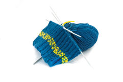 Knitting blue pattern and ball of wool. Blue ball of wool with knitting needles royalty free stock photography
