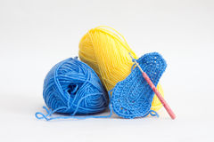 Knitting bootees with a hook Stock Photos