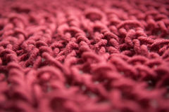 Knitting bordo or burgundy textured wool background, close up, old style Royalty Free Stock Photos