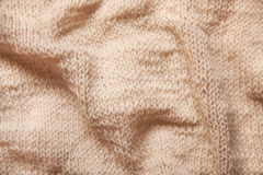 Knitting brown or beige textured wool background, close up of wrinkled fabric Stock Photo