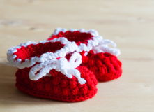 Knitting. Christmas baby`s bootees, close up Stock Photo
