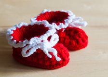 Knitting. Christmas baby`s bootees, close up Royalty Free Stock Image