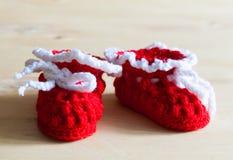 Knitting. Christmas baby`s bootees, close up Royalty Free Stock Photos