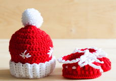 Knitting. Christmas hat, baby`s bootees, close up Royalty Free Stock Image