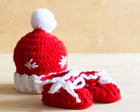 Knitting. Christmas hat, baby`s bootees, close up Stock Photo
