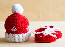 Knitting. Christmas hat, baby`s bootees, close up Stock Images