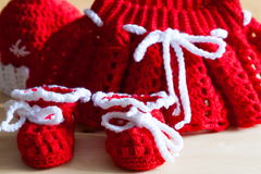 Knitting. Christmas hat, skirt, baby`s bootees, close up Royalty Free Stock Images