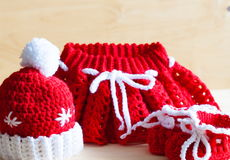 Knitting. Christmas hat, skirt, baby`s bootees, close up Royalty Free Stock Photos