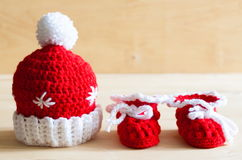 Knitting. Christmas hat, skirt, baby`s bootees, close up Stock Images