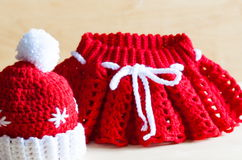 Knitting. Christmas hat, skirt, close up Royalty Free Stock Photography