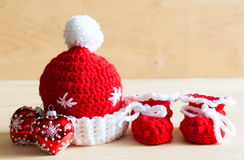 Knitting. Christmas hat, tree toy, baby`s bootees, close up Stock Images