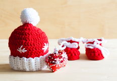 Knitting. Christmas hat, tree toy, baby`s bootees, close up Stock Photos