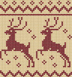 Knitting christmas seamless pattern with a deer Stock Images