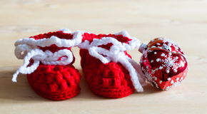 Knitting. Christmas tree toy, baby`s bootees, close up Royalty Free Stock Image