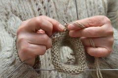 Knitting. Closeup of female hands knitting wool socks Stock Photo