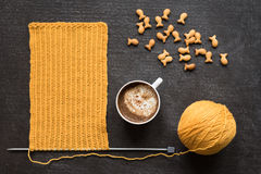 Knitting, coffee and fish crackers Stock Image