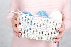 Knitting concept female hands with color clew ball Royalty Free Stock Photo