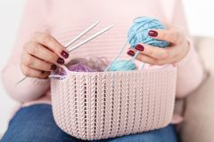 Knitting concept female hands with color clew ball Royalty Free Stock Photos