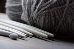 Knitting and crocheting tools. Handmade knitting and crocheting crafts stock images