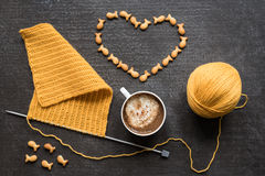 Knitting, cup of coffee and crackers heart Stock Image