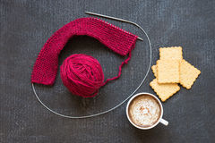 Knitting, cup of coffee and crackers Stock Image