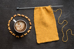 Knitting, cup of coffee and fish crackers in circle Royalty Free Stock Images