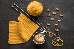 Knitting, cup of coffee and fish crackers Stock Photography
