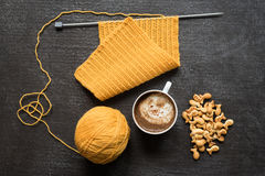 Knitting, cup of coffee and fish crackers Royalty Free Stock Photography