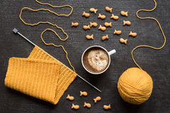 Knitting, cup of coffee and fish crackers Stock Photo