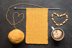 Knitting, cup of coffee and fish crackers heart Stock Photo