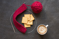 Knitting, cup of coffee and five crackers Royalty Free Stock Images