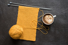 Knitting and a cup of coffee Royalty Free Stock Image