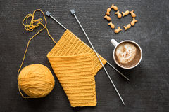 Knitting, cup of coffee and heart Stock Images