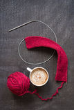 Knitting and a cup of coffee Stock Images