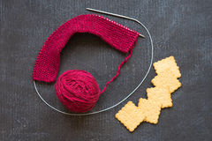 Knitting with a cup of coffee Stock Photo