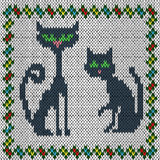 Knitting fabric pattern with two grey cats Royalty Free Stock Photo