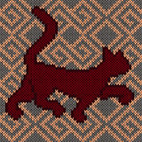 Knitting fabric seamless pattern with red rambling cat Royalty Free Stock Photos