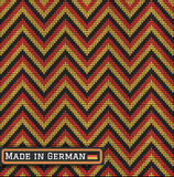 Knitting German colors pattern sweater battlement. Fair Pattern sweater italian design on the wool knitted texture. Seamless Knitting Ornament. Germany flag Royalty Free Stock Photos