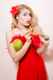 Knitting girl in red dress with flower barrette Royalty Free Stock Photo