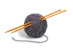 Knitting. Gray ball of yarn for knitting Royalty Free Stock Images